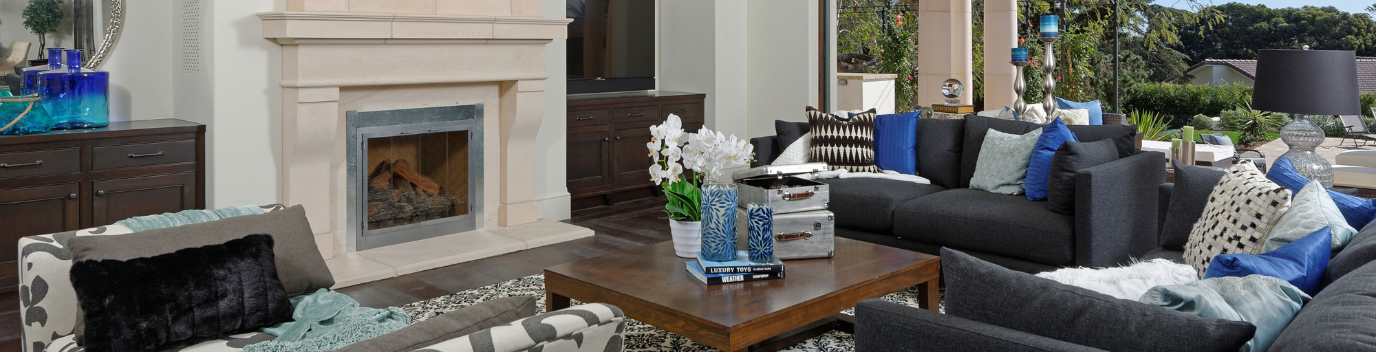 Living room staging with grey and blue accents