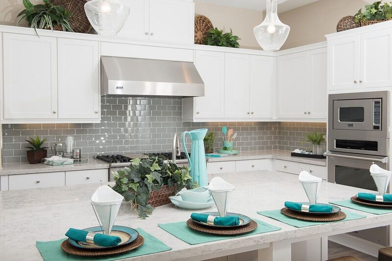 Kitchen staging with white and turquoise staging