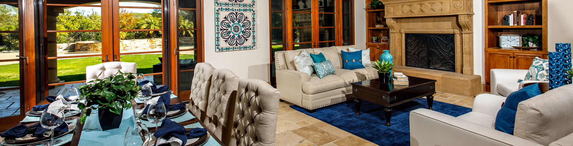 Brown and blue toned staging of living room and dining room