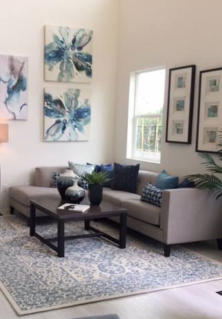 Living room staging with art, furniture and accessories