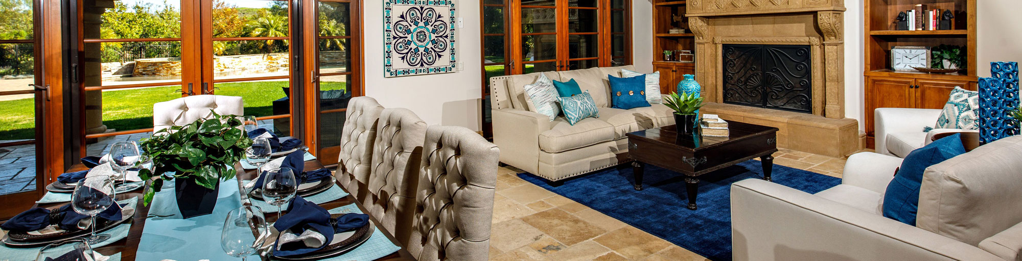 Living room and dining room staging with beige and blue accests